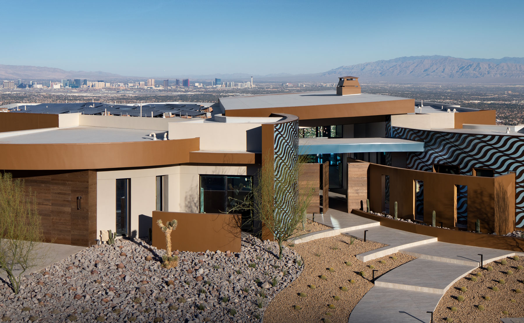 Exterior shot of the 2020 NAHB New American Home by Sunwest set in the mountains outside of Las Vegas, overlooking the strip.
