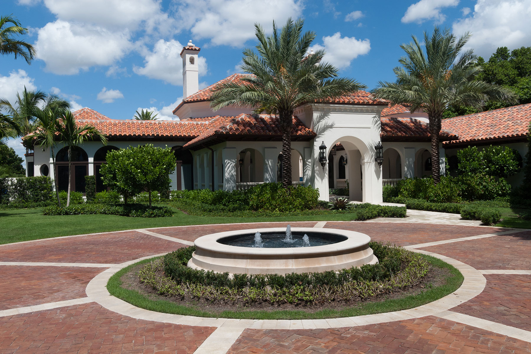 A round drive greets visitors to this renovated Palm Beach estate