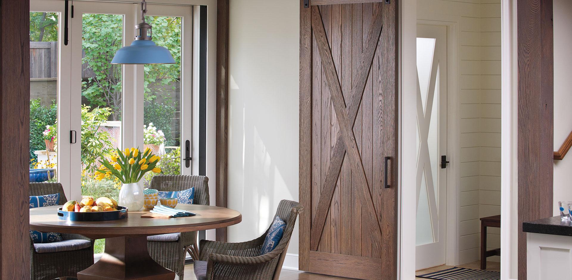Breakfast nook with rustic barn door