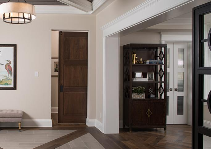 TS3000 doors in walnut with Edelman® Croc Nuts leather panels