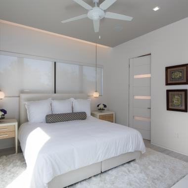 Matching TM9320 doors with White Lami glass add a modern finish to this guest room