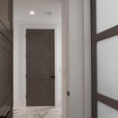 Linea Tiered Moulding and White Lami glass featured throughout the home create clean profiles for a modern take on a traditional panel door