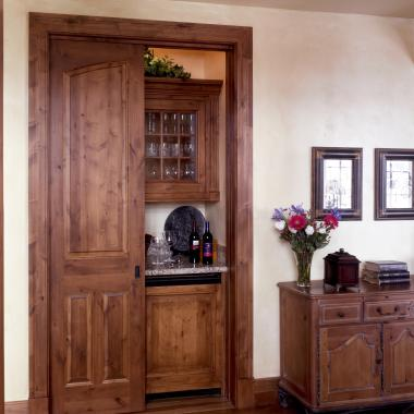 TS3090 pocket doors in knotty alder with Roman Ogee (OG) sticking and Raised (A) panel.