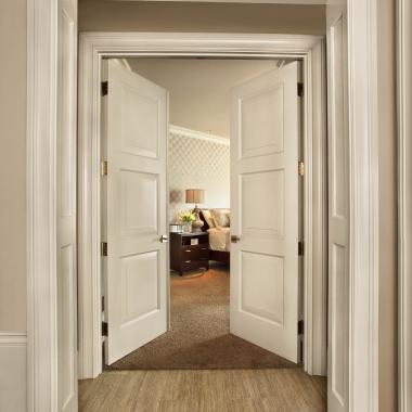 Pair of TS3000 bedroom doors in MDF with custom sticking and senior raised (E) panel.