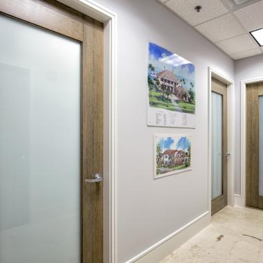 TM1000 office doors in white oak with custom ceruse finish and white lami glass