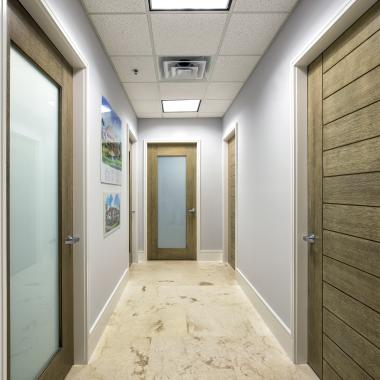 TM13000 and TM1000 office doors in white oak with custom ceruse finish and white lami glass
