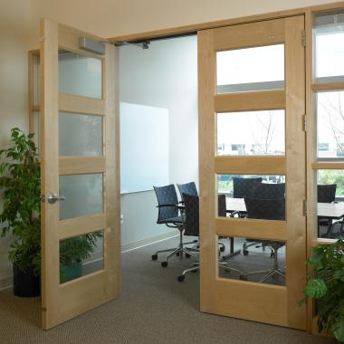 Pair of TS4100 conference doors in plain-sliced birch with glass panels