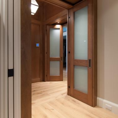 TS2020 bedroom doors in walnut and white lami glass feature harmon hinges. TS4100 in MDF in foreground.