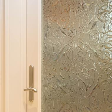 Detail of FL100 pantry door in MDF with quarter round sash and custom glass