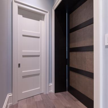TS4100 door in MDF with square stick (SS) sticking and flat (C) panel. On right, TS4100 barn door in wire-brushed white oak and Edelman Shagreen leather.