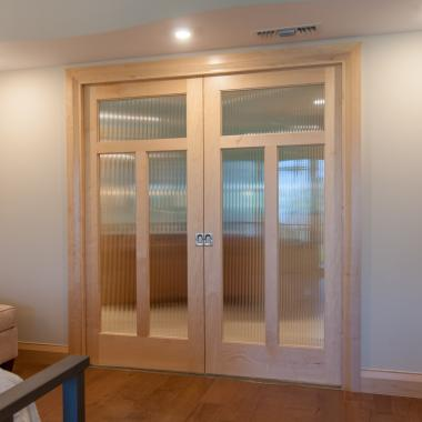 Pair of TS3240 doors in maple with reeded glass.
