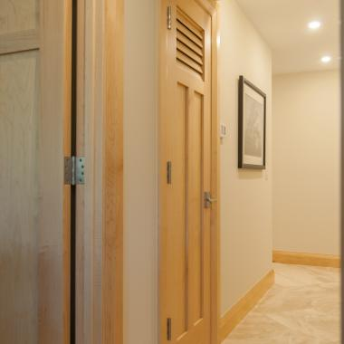 A louver panel added to this TS3240 maple door provides ventilation to the utility closet.