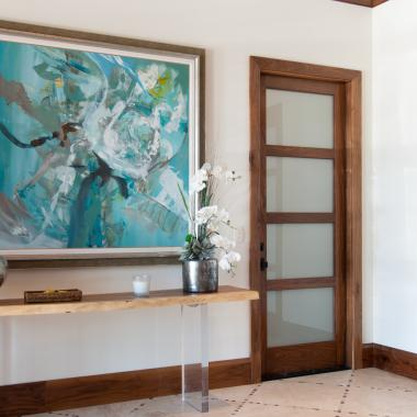 Foyer features TS4100 door in walnut with white lami glass