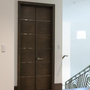 Pair of TMIR6000 doors in white oak with bright stainless inlay.