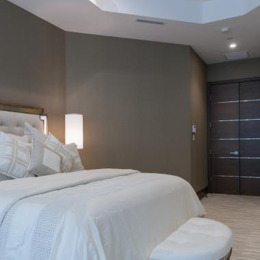 Bedroom featuring TMIR6000 doors in white oak with bright stainless inlay.