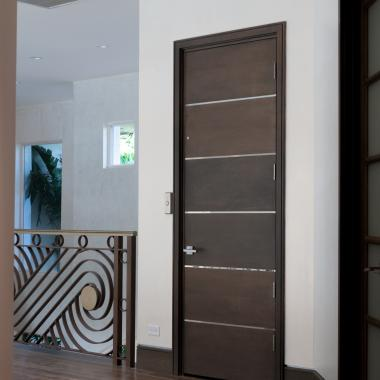 Elevator with TMIR6000 in white oak with bright stainless inlay.