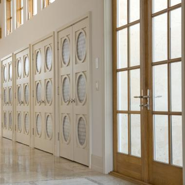 Bank of AD3030 doors in MDF with 3Form® Capiz resin