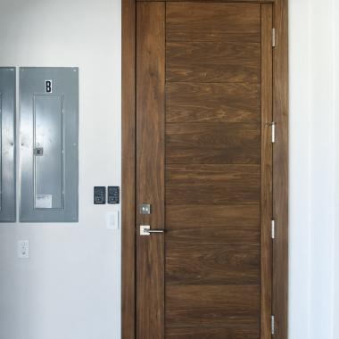 zoom TM9000 house-to-garage fire door in walnut with asymmetric stiles and kerf cut & Photo Gallery   TruStile Doors Pezcame.Com