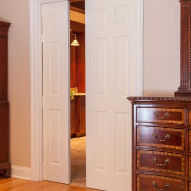 Pair of TS6000 pocket doors in MDF with Roman Ogee (OG) sticking and Raised (A) panel