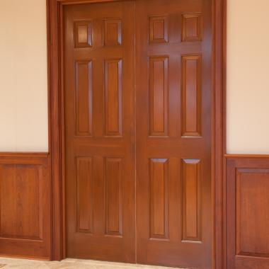 Pair of TS6000 pocket doors in MDF with Roman Ogee (OG) sticking and Raised (A) panel. Doors have been faux finished to resemble wood.
