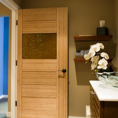 TM9220 bathroom door with asymmetric stiles and kerf cut reveal in LVL with Patina Etruscan metal panel.