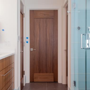 TM1000 bathroom doors in walnut with one step (OS) sticking and flat (C) panel