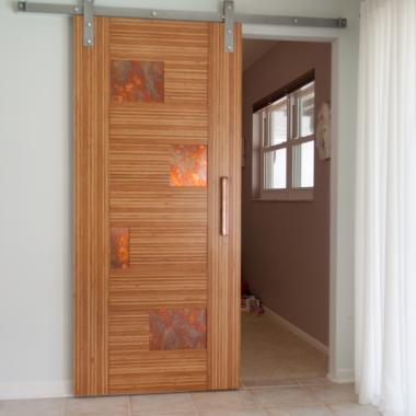TM9440 barn door in LVL with Patina Aurora Chemetal® panels