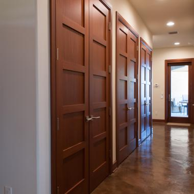 Hallway featuring pairs of TS5000 doors in mahogany with Square Stick (SS) sticking and Flat (C) panel