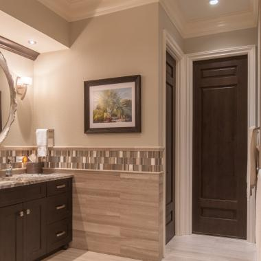 Bathroom featuring TS3080 door in knotty alder with Roman Ogee (OG) sticking and Raised (A) panel