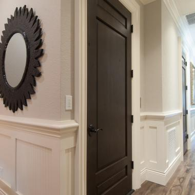 Hallway featuring TS3080 door in knotty alder with Roman Ogee (OG) sticking and Raised (A) panel