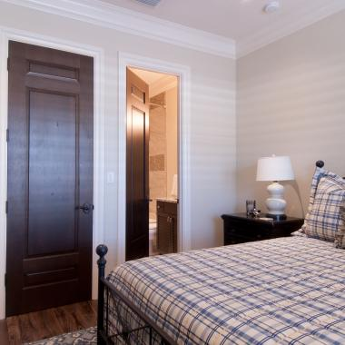 Guest room featuring TS3080 door in knotty alder with Roman Ogee (OG) sticking and Raised (A) panel