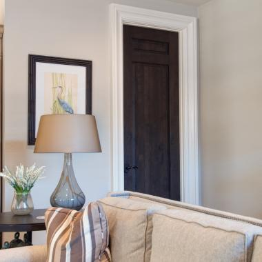 Living room featuring TS3080 door in knotty alder with Roman Ogee (OG) sticking and raised (A) panel.