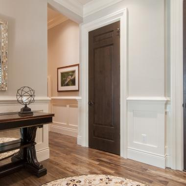 Hallway featuring TS3080 doors in knotty alder with Roman Ogee (OG) sticking and Raised (A) panel