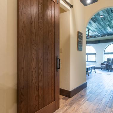 Hallway featuring VG1010 barn door in wire-brushed white oak.