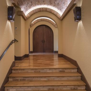 A barrel vaulted hallway features a radius-top VG1040 common arch pair in wire-brushed white oak.