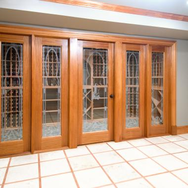 FL100 wine cellar door in mahogany with quarter bead (QB) sticking and custom etched glass