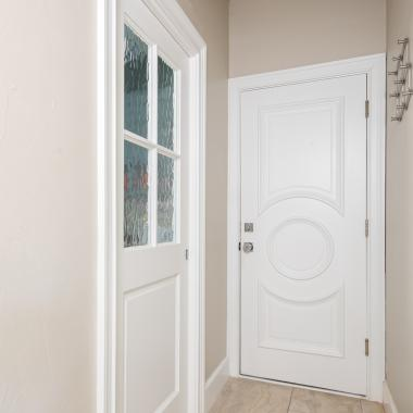 PL104 laundry room door in MDF with Roman Ogee (OG) sticking, Wave glass and Raised (A) panel on left. TS3140 door on right.