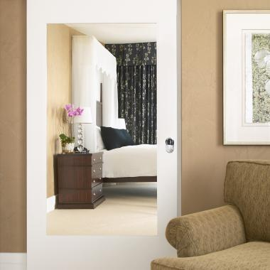 This TS1000 sliding barn door with inset mirror adds a dramatic accent to this high-end suite.