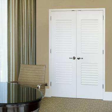 These LVR2020 louver doors lend an airy feel to this high-end hotel suite