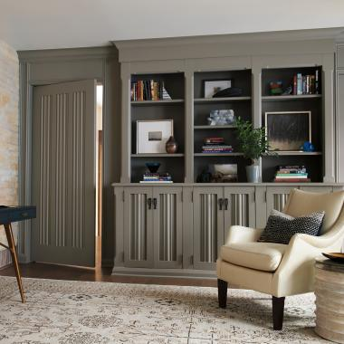 "To match the millwork in this historic home's study, a custom ""linen fold"" panel and sticking was applied to TS3010 doors in paint-grade poplar."