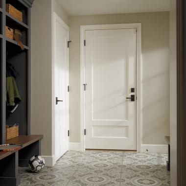 This mudroom features a 20-minute fire-rated house-to-garage TS2210 door in MDF with cove & bead (CB) sticking and flat (C) panel.