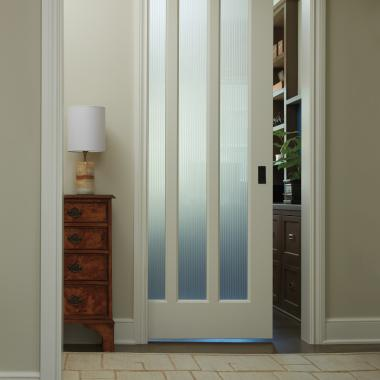 Tuxedo glass gives this pocket door a touch of privacy. TS3010 in MDF with cove & bead (CB) sash and Tuxedo glass.