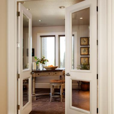 Pair of TS2020 doors in MDF with bevel glass and custom sticking that matches moulding used throughout the home.