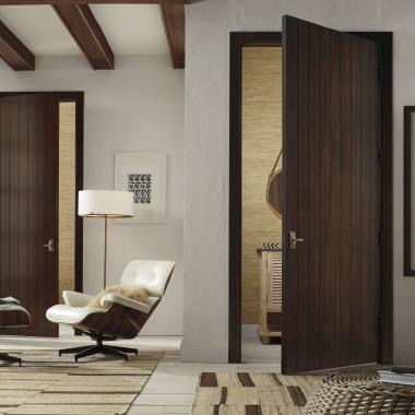 Plank doors (VG1000) in select alder with standard V-groove profile with Cinnamon stain with Rustic Antiquing package
