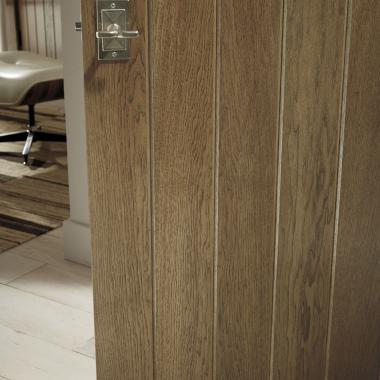 Detail of hickory plank door (VG1000) with wide V-groove profile and Cappuccino handwiped stain
