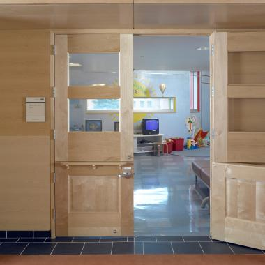 Pair of TS4100 dutch doors in plain-sliced birch with glass top panels