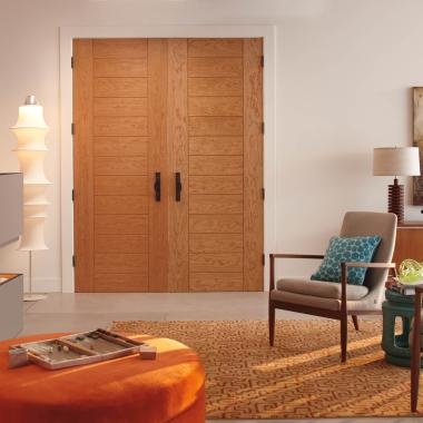 Mid-century modern room featuring TM13000 in cherry with kerf cut reveal.