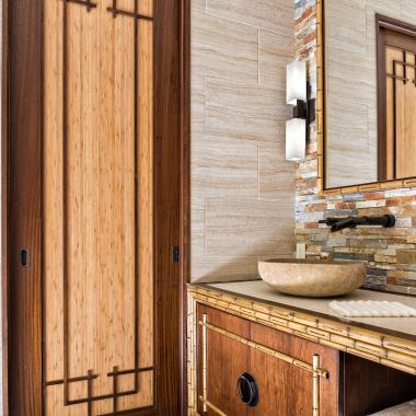Master Bathroom TS1000 pocket door in mahogany and bamboo with custom applied moulding