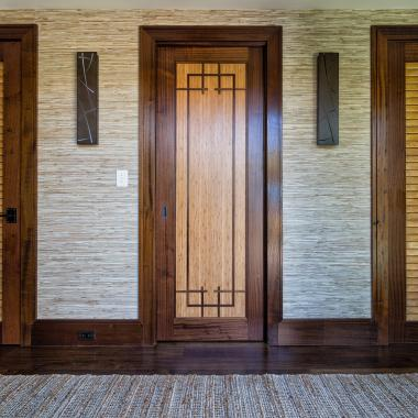 TS1000 pocket door in mahogany and bamboo with custom applied moulding. LVR1000 shown on the right and left.