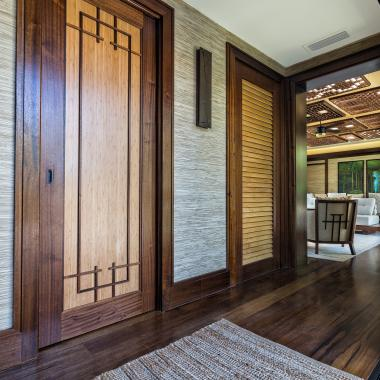 TS1000 pocket door in mahogany and bamboo with custom applied moulding. LVR1000 shown on the right.